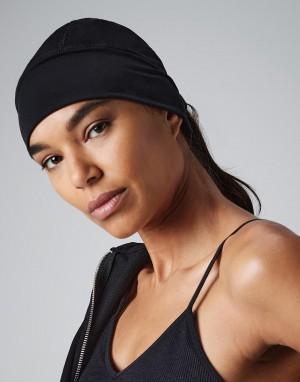 Sportinė vėjui ir vandeniui atspari, orui pralaidi kepurė iš minkšto audinio